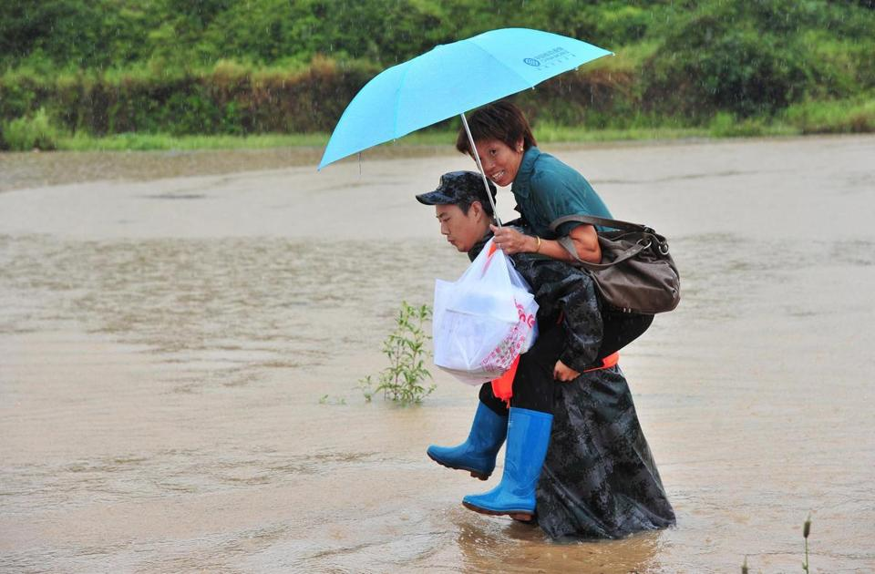 A rescue worker carried a flood victim in central China's Hunan province.