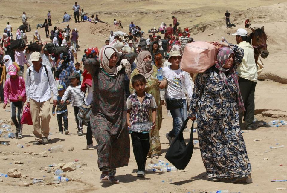 Syrian refugees crossed into Iraq at the Peshkabour border point in Dahuk on Tuesday. About 30,000 Syrians, the vast majority of them Kurds, have fled the region over five days.