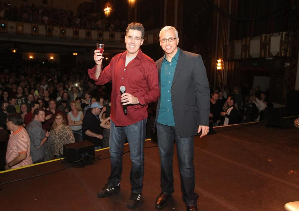 Adam Carolla (left) and Dr. Drew Pinsky at the Paramount Theater in Denver earlier this year as part of their reunion tour.