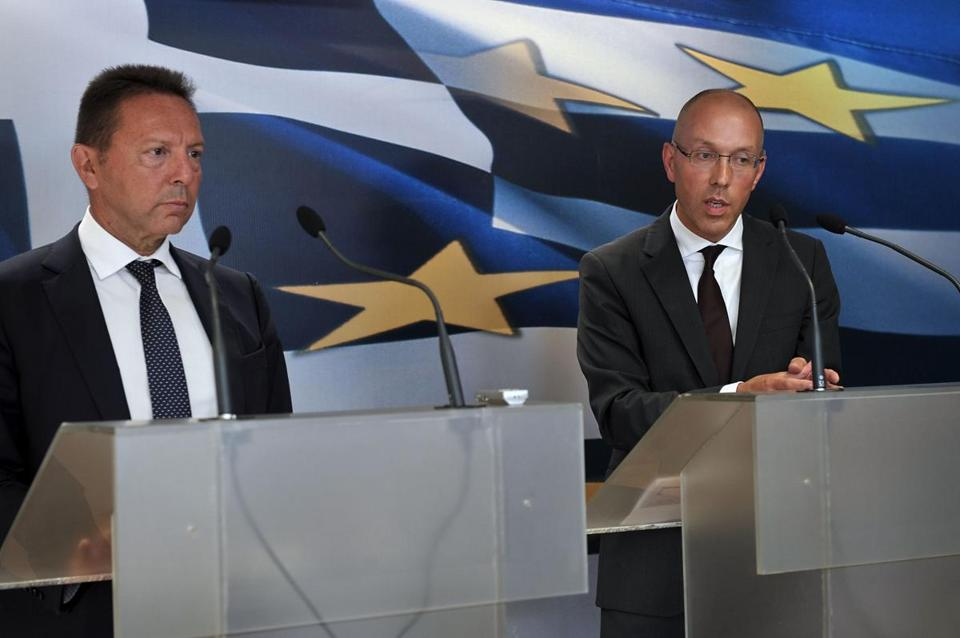 Greece's finance minister, Yannis Stournaras (left), and the European Central Bank's Joerg Asmussen spoke in Athens.
