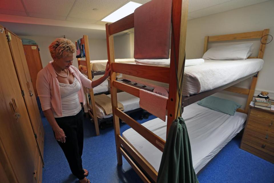 Veteran Barbara Barnes looked over her former bunk in the women's quarters of the New England Center for Homeless Veterans, which is planning a $21 million expansion for the fall of 2014. It will include more beds placed on a separate floor designated to female veterans, who may not feel comfortable sharing all of their space with the center's larger population of male veterans.