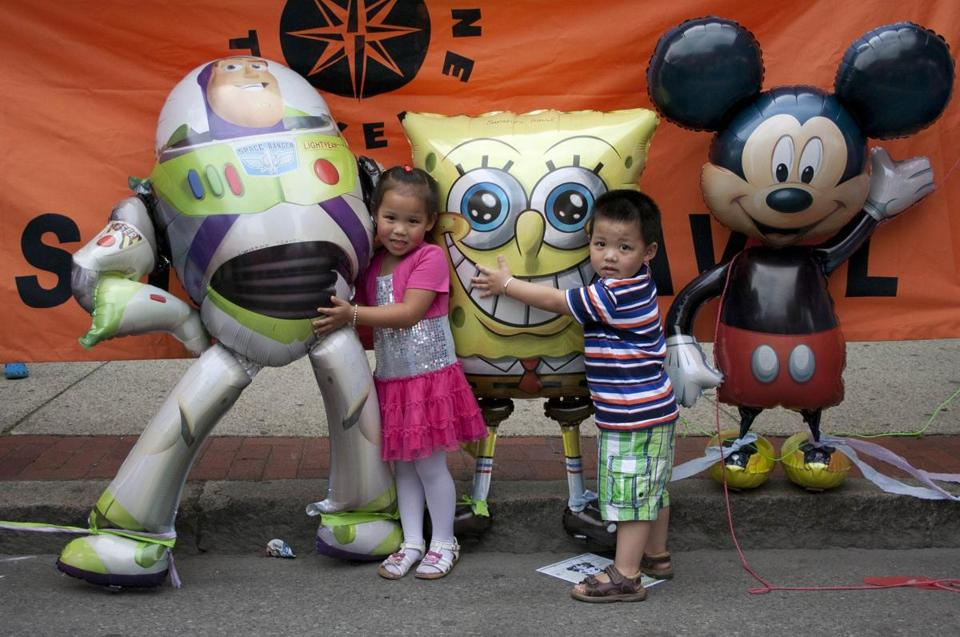 Lydia Zheng, 5, and 3-year-old Raymond Zheng found popular cartoon characters to greet.