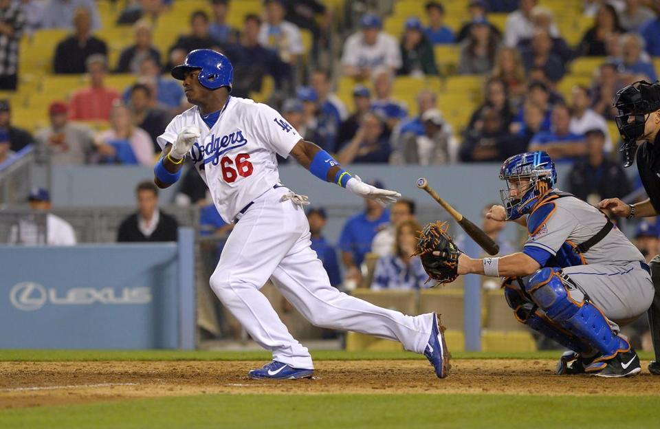 The Red Sox will get a look at impressive Dodgers rookie Yasiel Puig this week. (AP Photo/Mark J. Terrill)