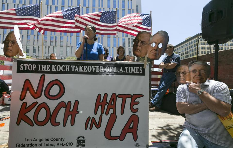 Union groups protested a possible sale to Koch Industries in Los Angeles in May.