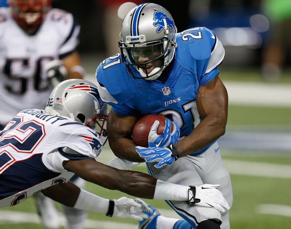 Lions running back Reggie Bush eluded Patriots safety Devin McCourty in the first quarter of Thursday's game.