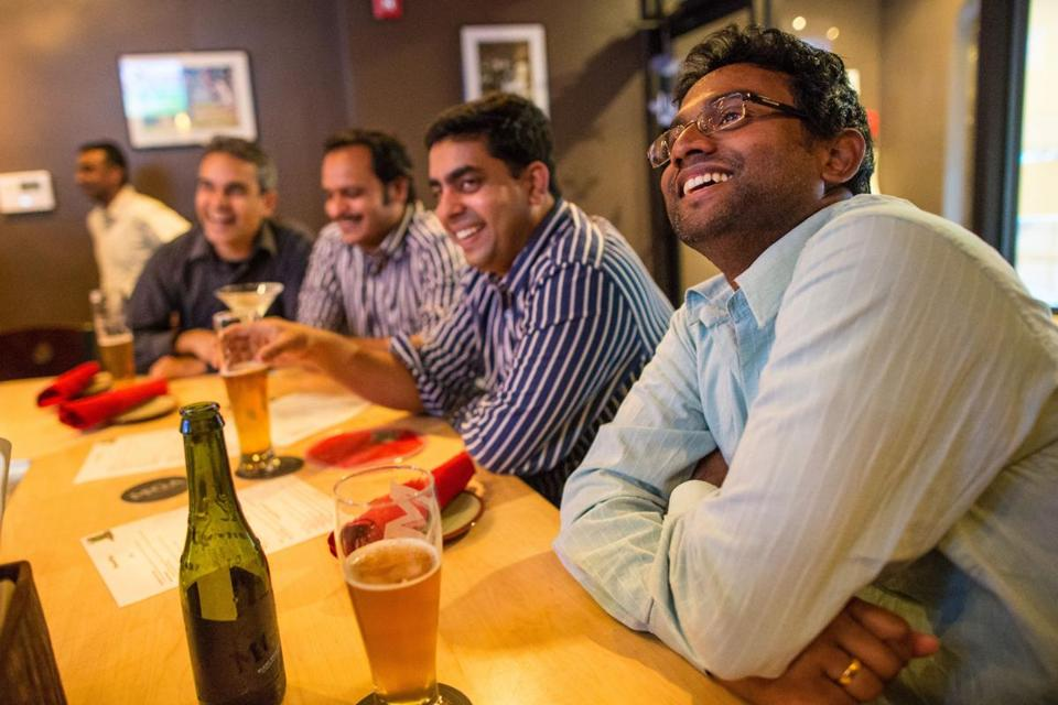 From right: Martin Mani, Brillo Babu, Arun Papineni, and Anish George work together and then watch together at Hit Wicket one Friday night in August.
