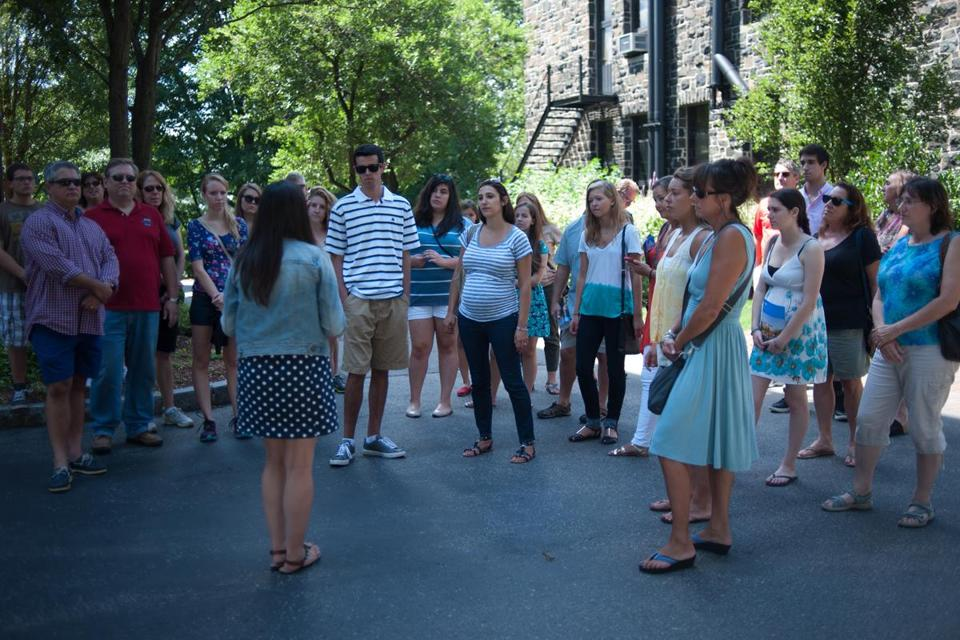 Student Jaime Morgan gave prospective students and their families a tour of the Tufts campus earlier this month. Tufts is seeing more applicants who need financial aid.