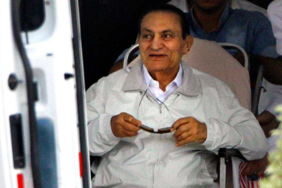 Hosni Mubarak, the former president of Egypt, was led to an ambulance Sunday for a trip to a courtroom in eastern Cairo.