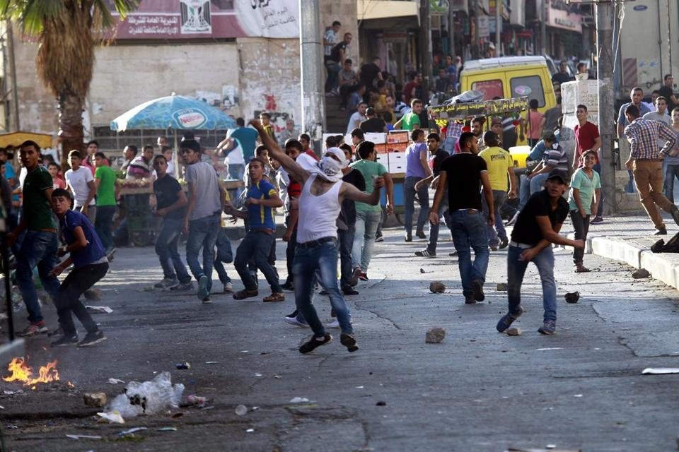 Palestinian protesters threw stones during clashes with Israeli security forces the West Bank city of Hebron on Monday.