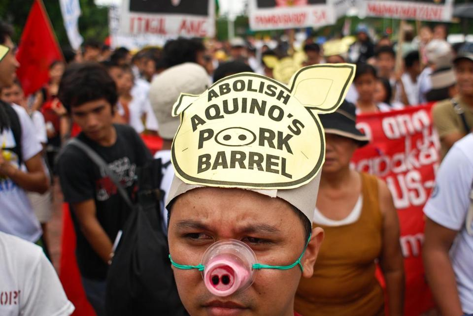 A protester wore a pig snout during a protest in Manila against the misuse of funds by Philippine government and business officials.