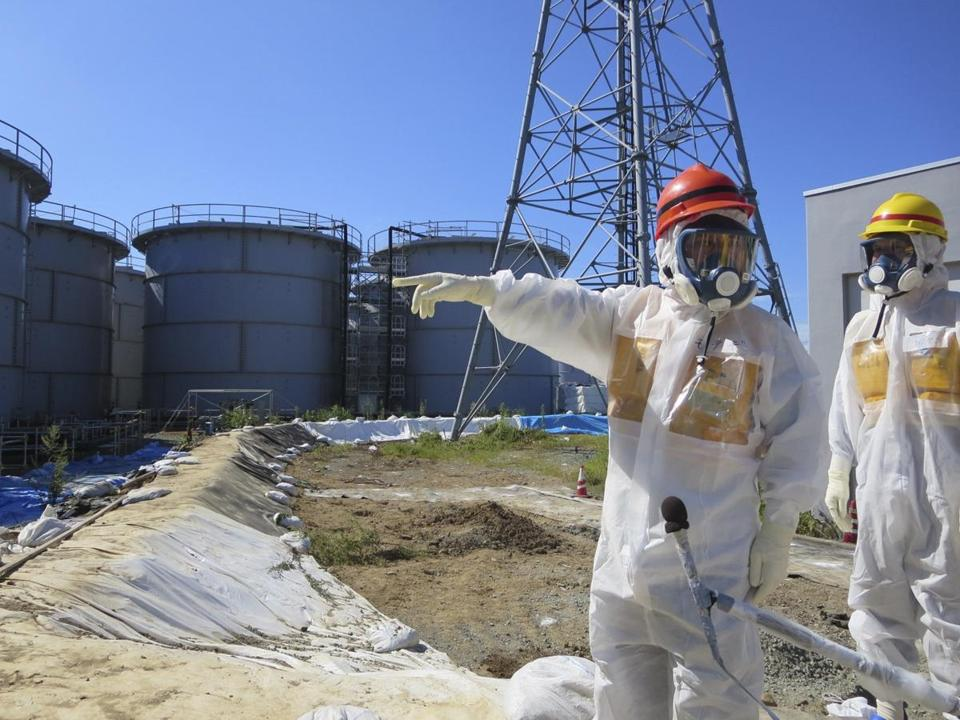Japan's trade minister, Toshimitsu Motegi, wore protective gear during a tour Monday of the Fukushima nuclear plant, where leaks of radioactive water have raised new concerns.