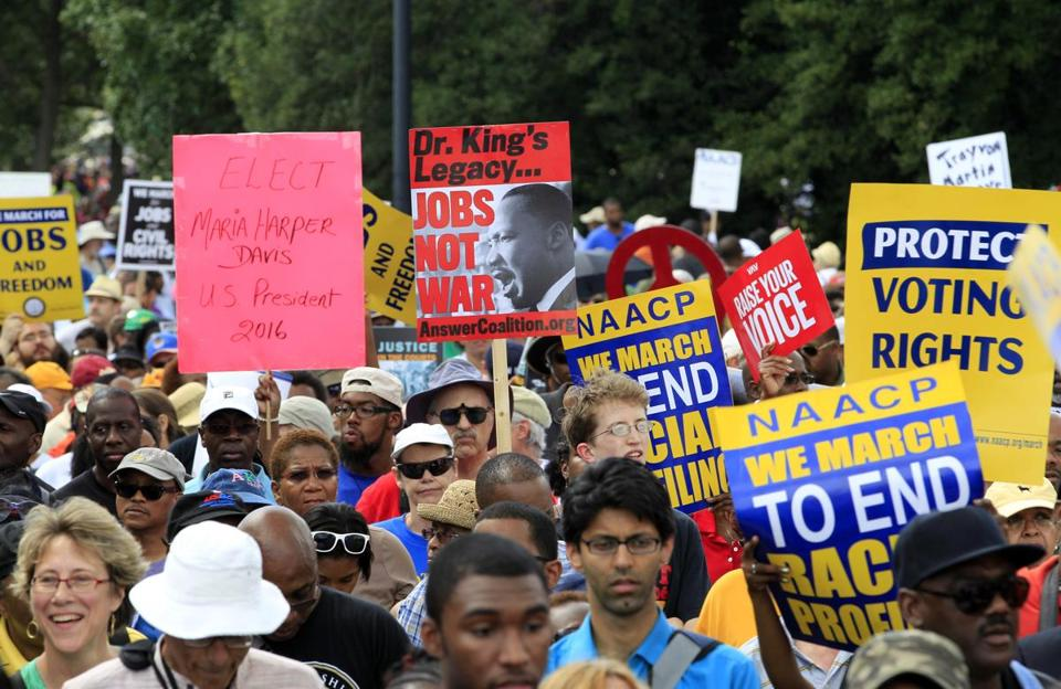 Tens of thousands of people marched Saturday to mark the 50th anniversary of the 1963 March on Washington.