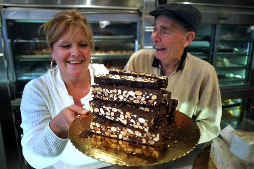 Maria Luberto held a tray of torrone at Modern pastry as owner Giovanni Picariello looked on.