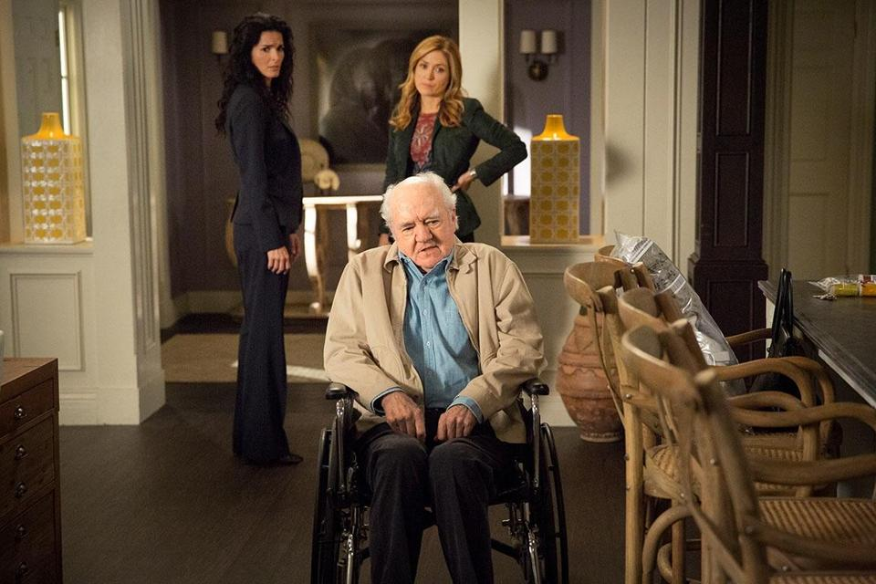 In this scene, Richard Herd is joined by actors Angie Harmon, left, and Sasha Alexander.