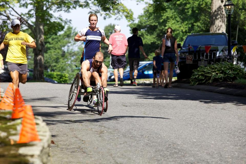 Twenty-nine-year-old Patrick Cogan of Lynn is not letting an incurable neuromuscular disease interfere with his pursuit of triathlon racing.