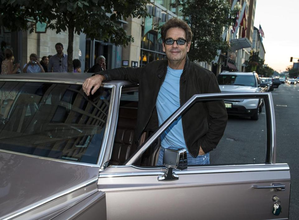 Huey Lewis, in town to play at Bank of America Pavilion, posed for a few photos with a vintage 1983 Cadillac Fleetwood Brougham.