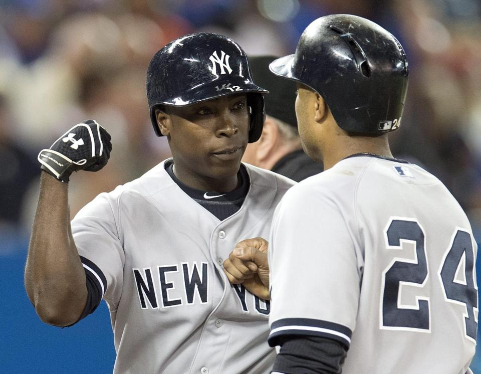 Alfonso Soriano is greeted by Robinson Cano after Soriano's first of two home runs against Toronto.
