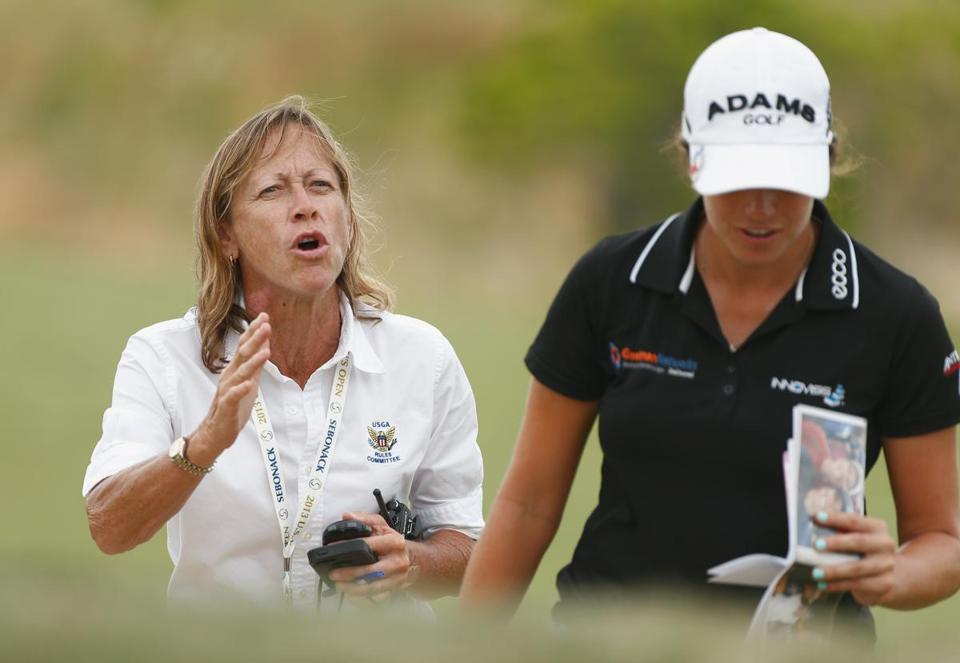 SOUTHAMPTON, NY - JUNE 27: USGA rules official Janet Lindsay speaks to a player about slow play during the first round of the 2013 U.S. Women's Open at Sebonack Golf Club on June 27, 2013 in Southampton, New York. (Photo by Scott Halleran/Getty Images)