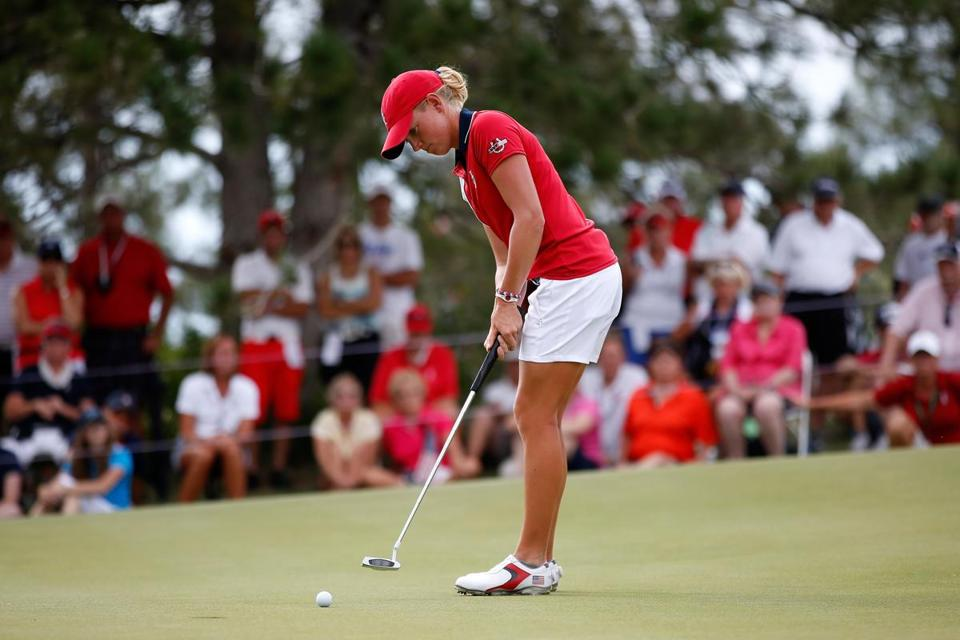 Stacy Lewis made a putt on the 18th green to halve her match during the final day singles matches of the 2013 Solheim Cup.