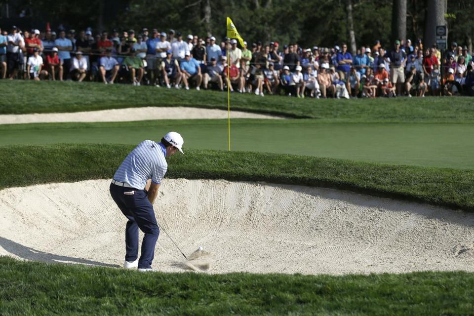 Keegan Bradley hits out of a bunker on the second hole during the first round of the PGA Championship golf tournament at Oak Hill Country Club, Thursday, Aug. 8, 2013, in Pittsford, N.Y. (AP Photo/Patrick Semansky)
