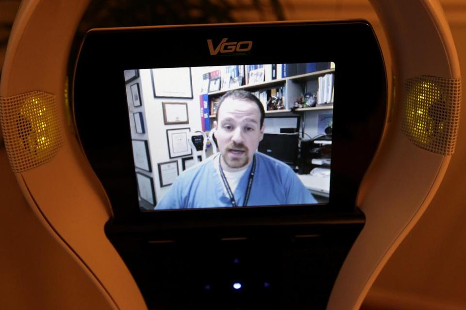 A doctor spoke with a patient via robot.