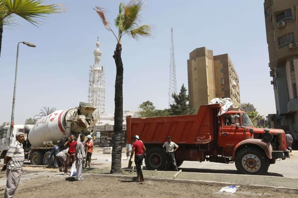 Workers repaired a street after a protest camp near the Rabaa al-Adawiya mosque in Cairo was cleared on Wednesday.
