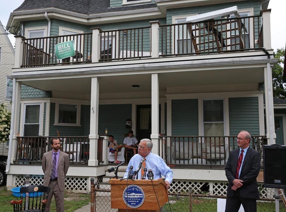 Flanked by Brian Swett (left) and Bryan Glascock of inspectional services, Mayor Thomas M. Menino spoke in Allston on Friday.