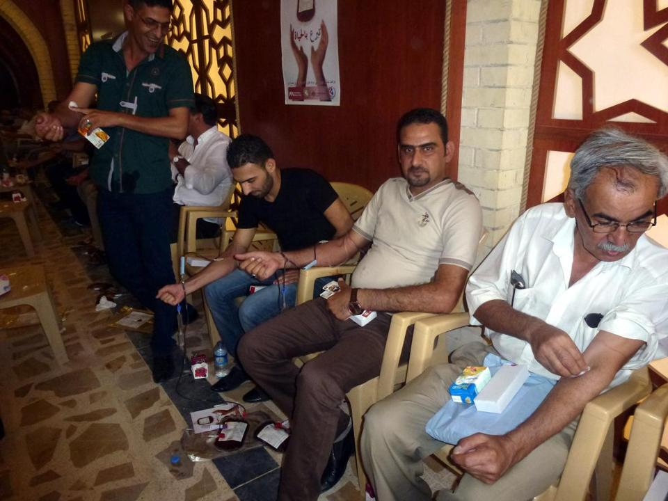 A group of Iraqi journalists volunteered to donate blood Friday in Baghdad, after  a month of deadly bombings.