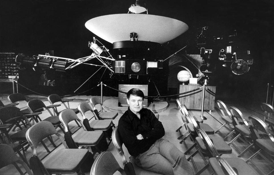 Dr. Bruce Murray sat near a full-scale model of the Voyager 1 spacecraft in 1979.