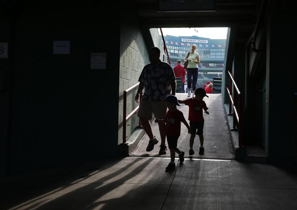 Fans moved down a walkway prior to a baseball game against the Orioles this week.