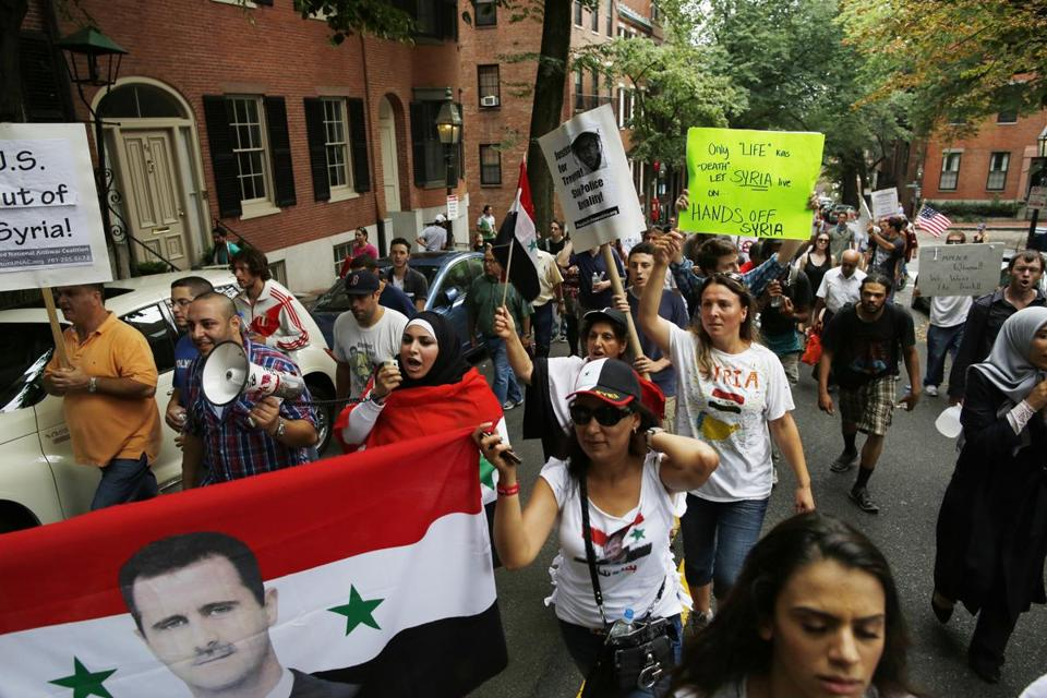Protesters carrying banners emblazoned with portraits of Bashar Assad protested plans for US action against Syria.