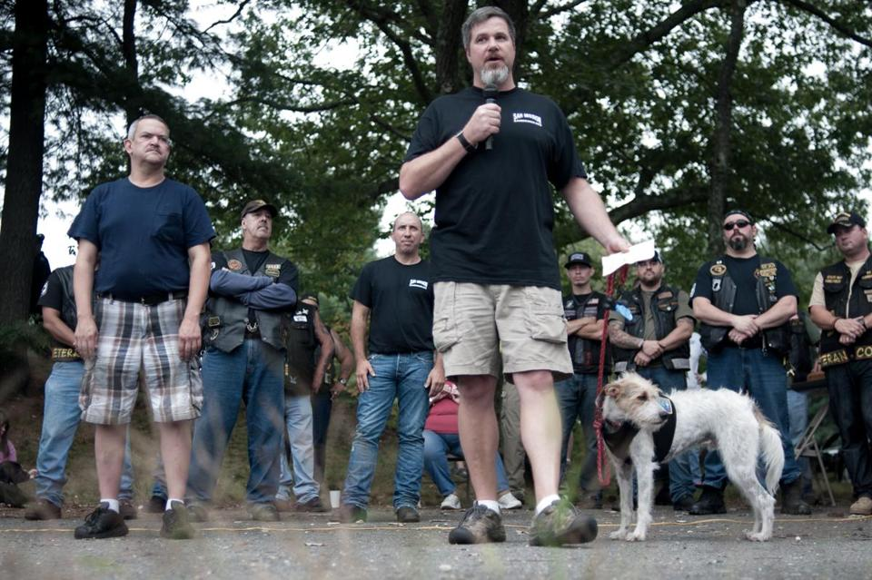 James Glaser addressed the crowd at a rally in support of PTSD awareness Saturday in Oxford accompanied by his service dog, Jack, and Russell Ireland (left), owner of Big I's Diner.