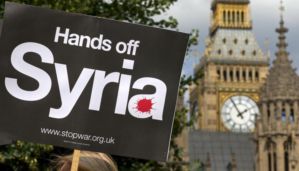 Demonstrators protested this week outside the Houses of Parliament in London against potential British military involvement in Syria.