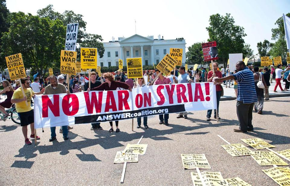 Demonstrators in front of the White House speak out against US intervention in Syria.