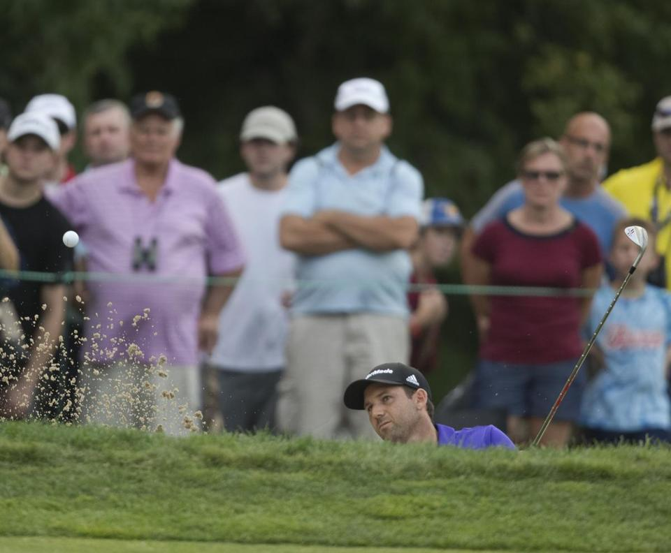 Sergio Garcia hits out of a trap on the 14th hole during the third round.
