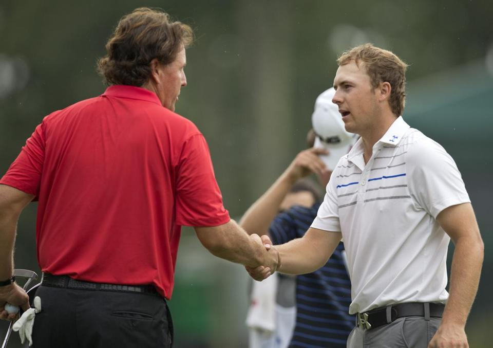 Jordan Spieth (right) is congratulated by Phil Mickelson after finishing the final round with a 9-under-par 62, one shot off the course record.