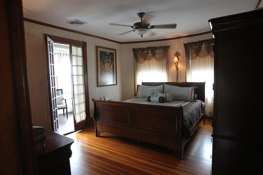 The master bedroom is one of three bedrooms in this American Foursquare.