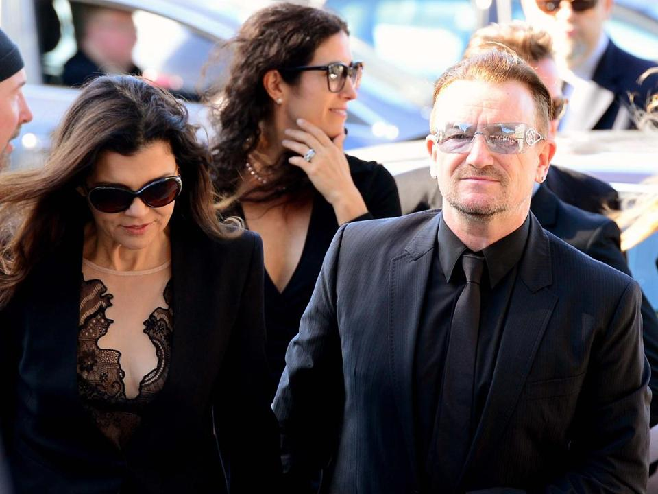 U2 singer Bono and his wife, Ali Hewson, at the funeral for Seamus Heaney on Monday
