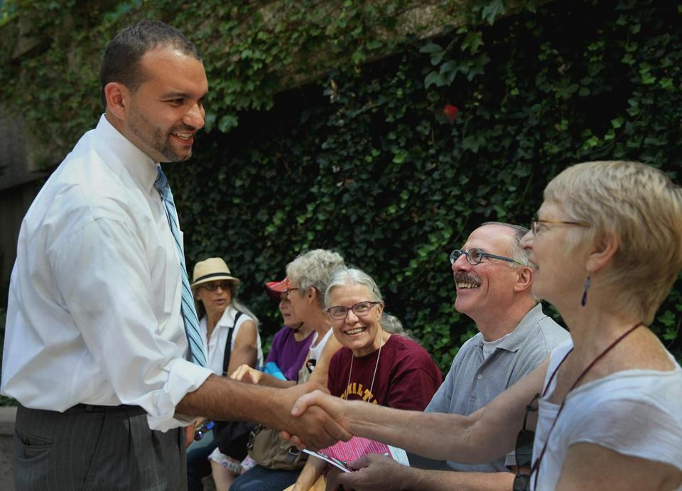 Felix Arroyo greets Bunny Meyer of Jamaica Plain before a March on Washington commemoration.