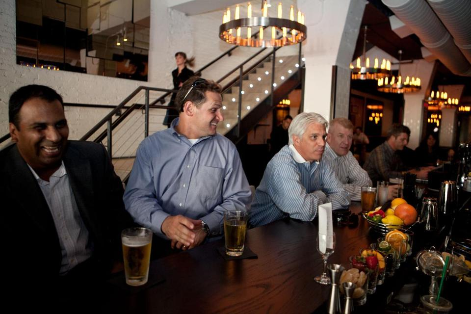 Parth Patel, Matt Kaighn, John Bennett, and Martin Story enjoyed a beer at the bar in the newly renovated Forum Bar and Restaurant.