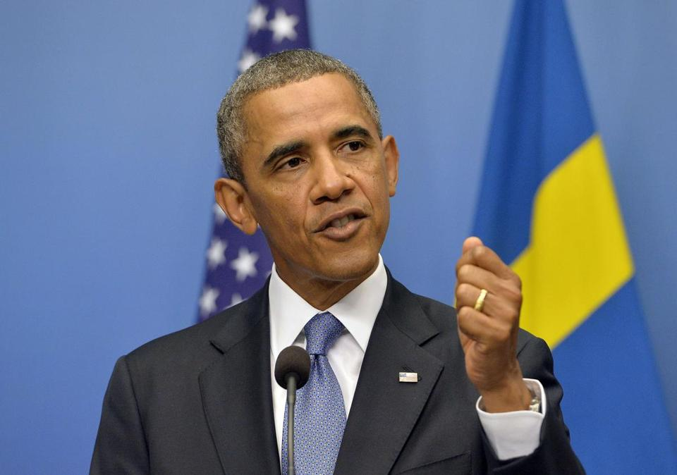 President Obama answers a question on Syria during a joing press conference with Swedish Prime Minister.