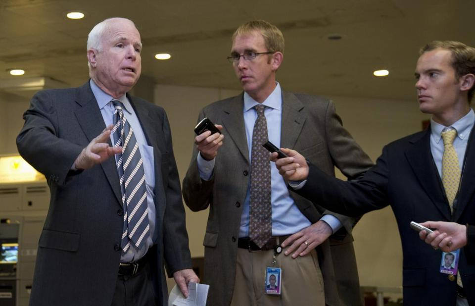 John McCain talked with reporters on Wednesday as he walked to a closed-door committee meeting on the authorization of the use of force in Syria.