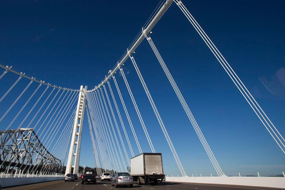 After decades of delay, the new San Francisco-Oakland Bay Bridge opened to traffic just before the start of the morning rush-hour commute on Tuesday.