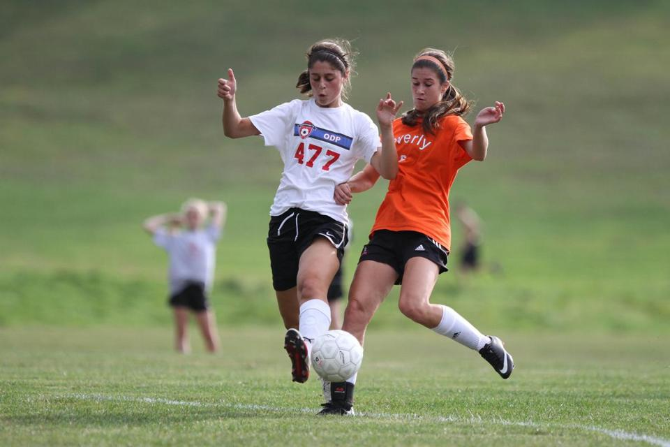 Beverly senior Caitlin Harty (right) battles Pingree's Nicole Scarfo during a scrimmage.