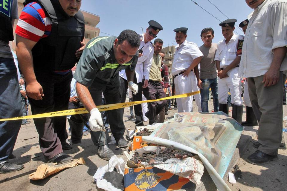 Officials inspected the scene of a blast targeting Interior Minister Mohammed Ibrahim in Cairo. One officer was killed.
