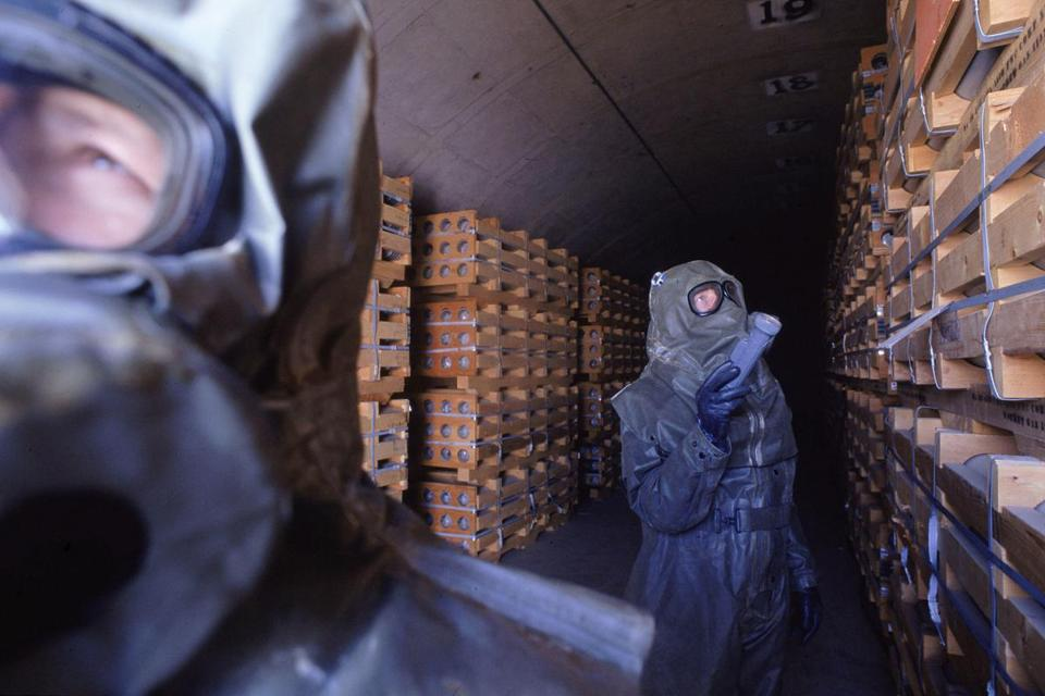 DESTROYING ASTOCKPILE: At an incinerator at the Toole Army Depot in Utah in 1995, workers checked a storage area filled with rockets armed with sarin gas.