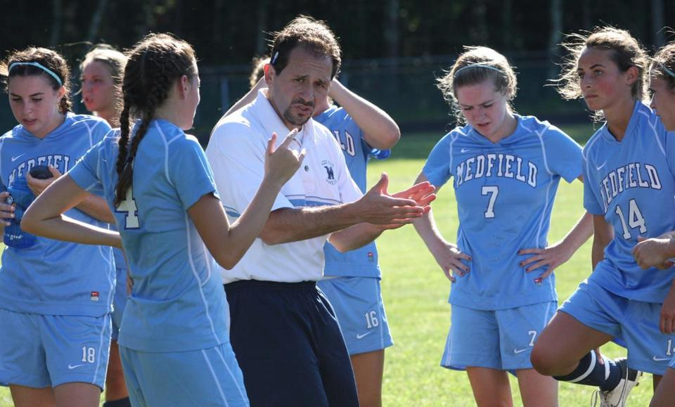 Medfield coach Mike LaFrancesca encourages team during timeout.