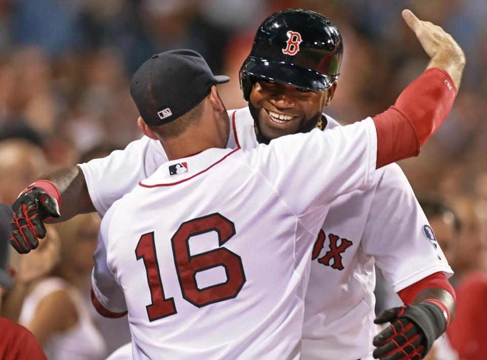 After hit 2,000, David Ortiz was hugged by Will Middlebrooks.