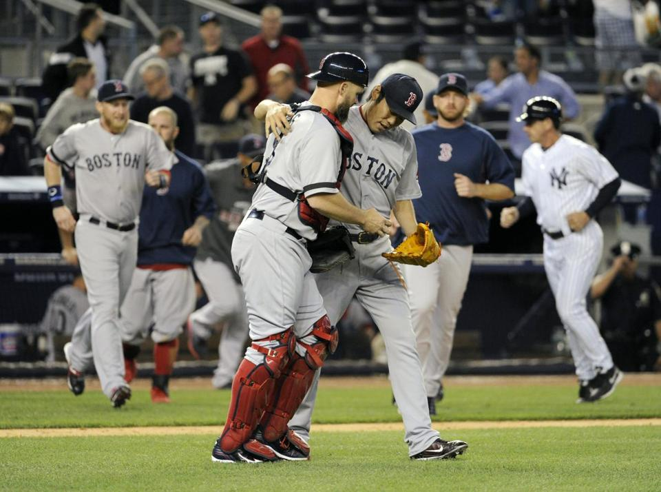 Koji Uehara, right, and David Ross celebrated after closing out a comeback win against the Yankees.