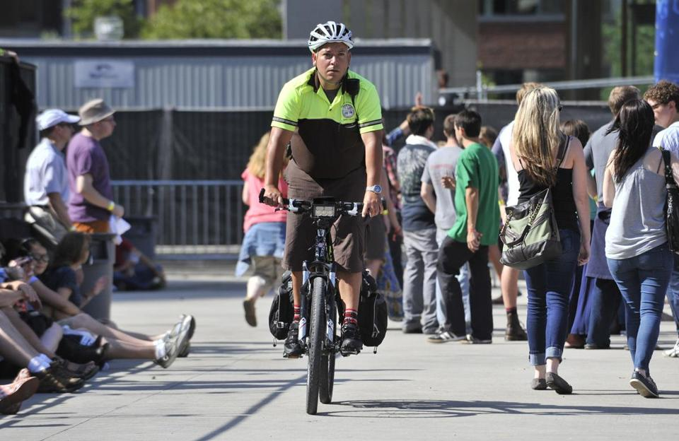 An EMT rode a bicycle around attendees at the Boston Calling music festival on City Hall Plaza.